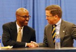 Reggie Witherspoon (left) shakes hands with Canisius College President John J. Hurley (right).  Photo Credit: Buffalo News