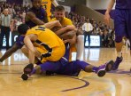 Battle of the Ball: A pair of Niagara players battles with a Canisius duo during a loose ball in first half action. (Marshall Haim/The Griffin)