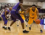 Jermaine Crumpton tries to dribble past Marvin Prochet during first half action at Niagara. (Marshall Haim/The Griffin)
