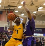 Malik Johnson drives to the basket during second half action at Niagara. (Marshall Haim/The Griffin)