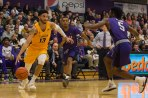 Isaiah Reese dribbles past two Niagara defenders during first half action. (Marshall Haim/The Griffin)