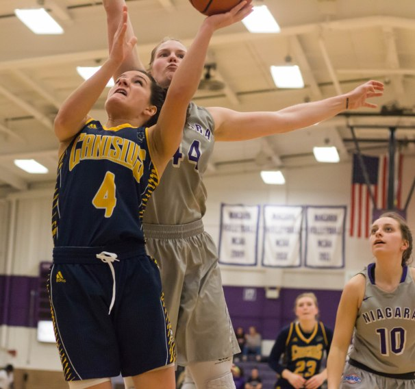 Niagara's Kaylee Stroemple blocks Anna Sweny's layup attempt during second half action. (Marshall Haim/The Griffin)